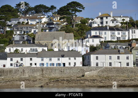 The picturesque harbour and frontage at the small village of St Mawes on the River Fal in Cornwall - Stock Photo