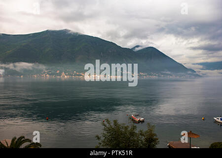 Looking across the Boka Kotorska (the Bay of Kotor) to Prčanj from the village of Dobrota, Montenegro - Stock Photo