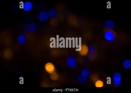 Defocused lights on black background - Stock Photo