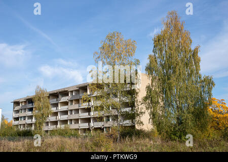 Old abandoned houses in central europe. Destroyed blocks of flats from an old military unit. Season of the autumn. - Stock Photo