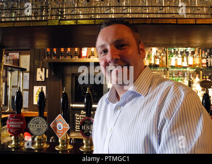 London, UK. 17th Sep, 2018. Patrick Linn, manager of the pub 'The Lamb and Flag', stands in the pub in London's Covent Garden quarter. He sees the sharp rise in taxes as a reason for the death of pubs in Great Britain. (to dpa 'Pub Dying: Why more and more pubs in Great Britain close down' from 10.10.2018) Credit: Naoual Abardah/dpa/Alamy Live News - Stock Photo