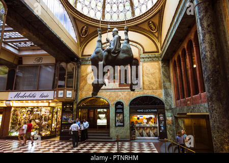 Upside-Down Statue of King Wenceslas Riding a Dead Horse By Czech sculptor David Černý at Lucerna Passage shopping center in Prague Czech Republic - Stock Photo