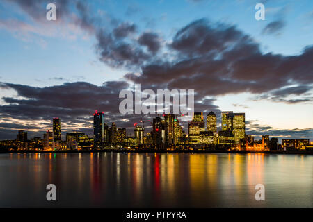 City lights over the River Thames and Canary Wharf, London Docklands, London, UK - Stock Photo
