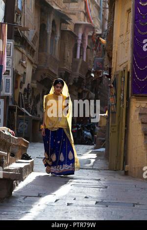 The image of Rajasthani Ladies walking in the street of  Jaisalmer, Rajasthan, India - Stock Photo