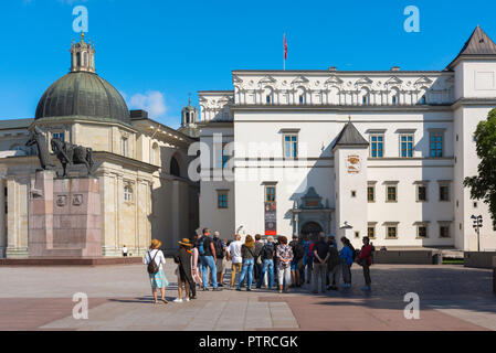 Tourism tourists europe, a tour group stands in Cathedral Square in Vilnius on a summer morning looking at the Palace of the Grand Dukes of Lithuania. - Stock Photo