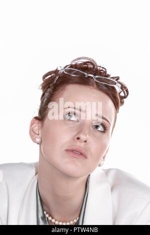 Frau, 20-30 Jahre, Arbeit, Ausstrahlung, Bluse, Business, Haare, Hochsteckfrisur, Portrait, Brille, bruenett, gutaussehend, hochgesteckt, nachdenklich - Stock Photo