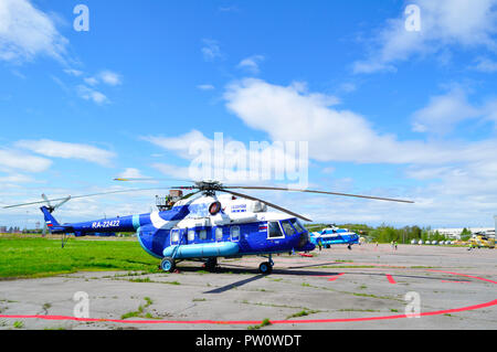 St Petersburg, Russia - May 23,2015. RA-22422 Mil Mi-8 AMT helicopter of Gazpromavia Aviation Company at the parking in Pulkovo airport - Stock Photo
