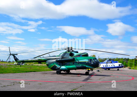 Saint Petersburg, Russia - May 23,2015. The Mil Mi-8 helicopters of Spark Avia Airline Company and Special Aviation Department of the Ministry of Inte - Stock Photo