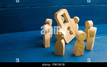 Bank secrecy, medical secret. Wooden figures of people stand around a padlock on a blue background. The concept of security and security, the protecti - Stock Photo