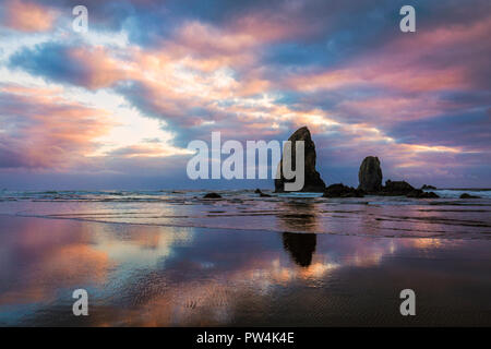Afterglow on the Haystack Needles near Cannon Beach, Oregon, USA. - Stock Photo