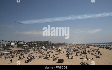 The Royal Canadian Snowbirds fly over a crowd of spectators at the 2017 Breitling Huntington Beach Air Show in Huntington Beach, Calif., Sept. 30, 2017. The 2017 Breitling Huntington Beach Air Show consisted of performances from a variety of aerial demonstration teams flying modern aircraft and vintage war planes allowing Huntington Beach citizens and community members to see the progression of our nation's aviation history. - Stock Photo