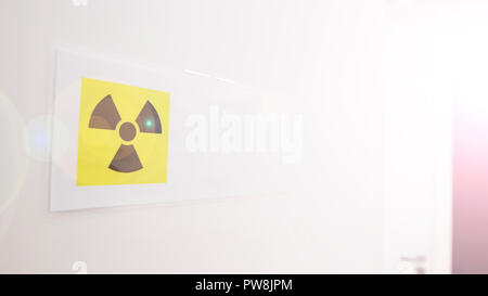 CAUTION: X-RAY IN USE warning sign posted on open door to dental room. - Stock Photo