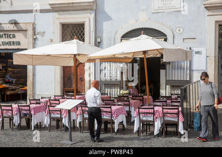 Traditional red and white tablecloths on italian restaurants in Piazza Del Rotonda,Rome city centre, Lazio,Italy - Stock Photo
