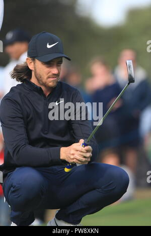 Walton Heath Golf Club,  13th Octoberr, 2018.    Tommy Fleetwood lines up his putt on the 14th green on the third day at  the SkySports British Masters golf championship hosted by Justin Rose Credit: Motofoto/Alamy Live News - Stock Photo