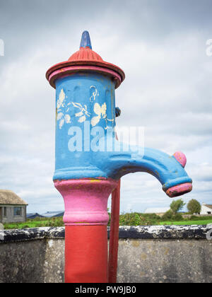 A traditional water pump in Cloughanover, near Headford in County Galway, Ireland. - Stock Photo