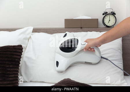 Mite vacuum cleaner using cleaning pillow bed mattress dust eliminator - Stock Photo