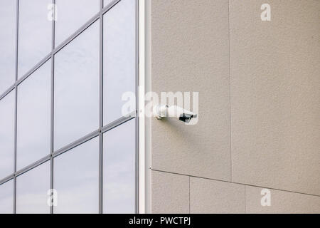 CCTV video camera security system on the wall of the building - Stock Photo