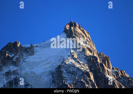 Aiguille du Midi in the evening sun, Mont Blanc massif, Chamonix-Mont-Blanc, French Alps, France. - Stock Photo
