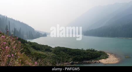 View of a lake in heavy forest fire smoke, north of Whistler, British Columbia, Canada - Stock Photo