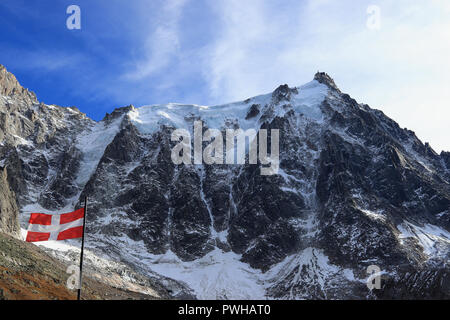 Aiguille du Midi (3,842 m / 12,605 ft) and the flag of Haute-Savoie, Mont Blanc massif, Chamonix-Mont-Blanc, French Alps, France. - Stock Photo