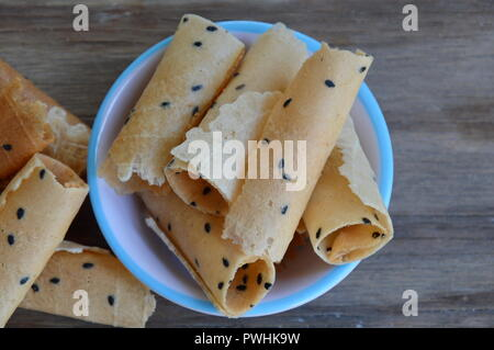 crispy rolled wafer traditional Thai dessert on cup - Stock Photo