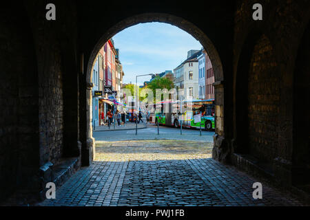 Aachen, Germany - October 12, 2018: view through the Ponttor with unidentified people. The Ponttor is one of the two remaining gates of the original c - Stock Photo