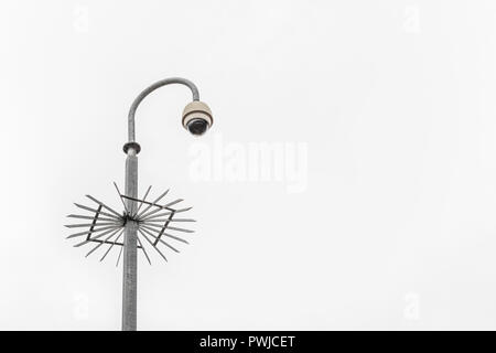 CCTV surveillance camera & bleak grey sky. Surveillance State & crime prevention metaphor, security system, privacy campaigners, face recognition. - Stock Photo