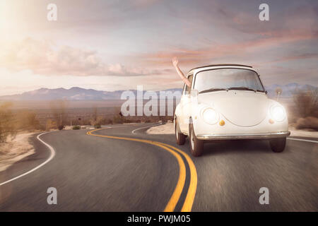 Road trip in a vintage car - Stock Photo