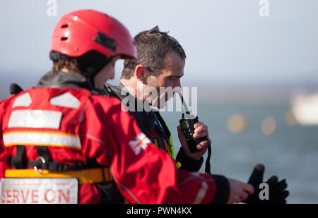 Two coast guards standing discussing work - Stock Photo