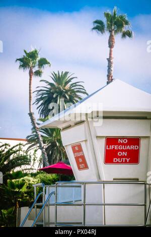 No Lifeguard on Duty Sign on a Life Guard Station in Laguna Beach, California - Stock Photo