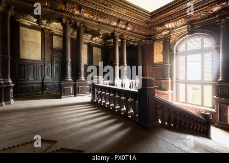 Interior view with abandoned staircase in the abandoned Palace Bozkow in Poland. - Stock Photo