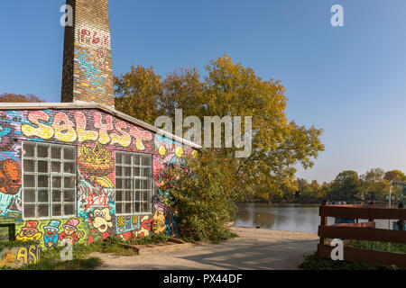 COPENHAGEN, DENMARK - October 2018: Building with grafitti by the canal in Freetown Christiania, a self-proclaimed autonomous neighbourhood in Copenhagen. - Stock Photo