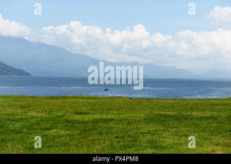 Lone fisherman on Lake Yojoa, the largest lake in Honduras - Stock Photo
