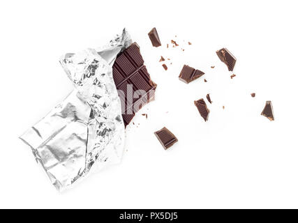 Chocolate Bar Tablet Wrapped in Aluminum Foil isolated over white Background. Some pieces are scattered around. Ideal for concepts. - Stock Photo