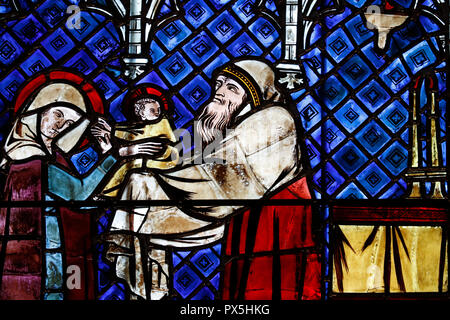 Our Lady of Strasbourg Cathedral. Stained glass window.  Presentation of Jesus at the Temple. 14 th century.  Strasbourg. France. - Stock Photo