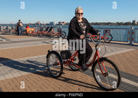 Detroit, Michigan - People try out adaptive bicycles, now offered through MoGo, Detroit's bike share system. The adaptive bikes are designed for peopl - Stock Photo