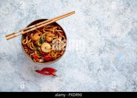 Traditional asian udon stir-fry noodles with shrimp - Stock Photo