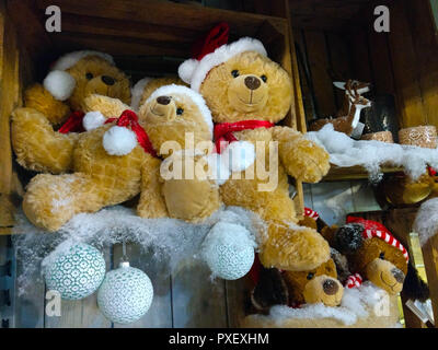 Christmas decorations in store. Furry teddybears in box in the snow. - Stock Photo