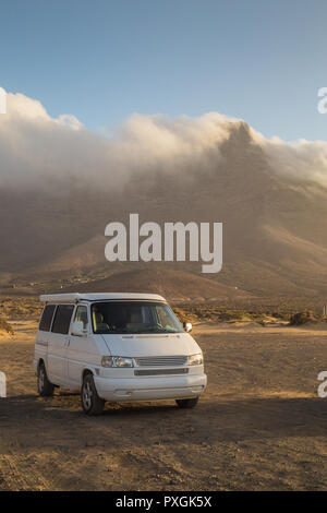 Camper van parked on Cofete beach in Fuerteventura. - Stock Photo