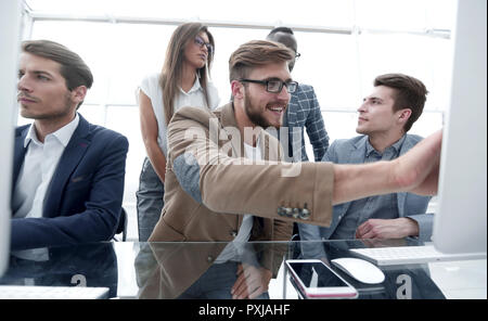 Programmer working in a software developing company office - Stock Photo