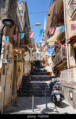 Decorated alley in the old town of Aci Trezza, municipality of Aci Castello, Catania, Sicily, Italy - Stock Photo