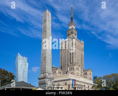 obelisk at the soc-realist Russian Wedding Cake style Palace of Culture and Science with the neomodern Warsaw Spire looming in the background, Warsaw, - Stock Photo