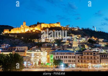 Narikala fortress above the Old Town, at dusk. Tbilisi, Georgia. Caucasus - Stock Photo
