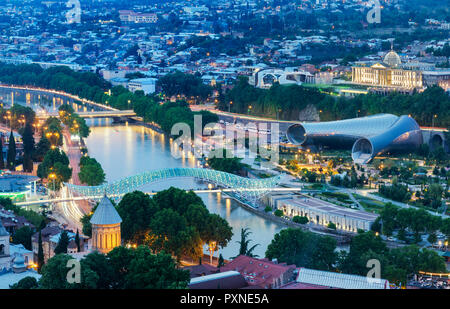 Bridge of Peace and the Mtkvari river. On the right, the Rike Park Music Theatre and Exhibition Hall and the Presidential Palace. Tbilisi, Georgia. Caucasus - Stock Photo