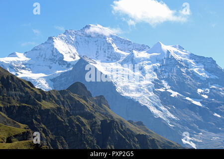 The stunning Jungfrau mountain and glacier, Switzerland overlooking traffic free village of Wengen. Perfect for hiking in Summer or Winter, and skiing - Stock Photo