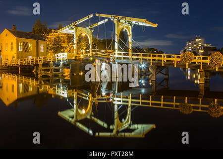 Rembrandt bridge and reflection in the river rijn in the city of Leiden at night, Holland, The Netherlands. - Stock Photo