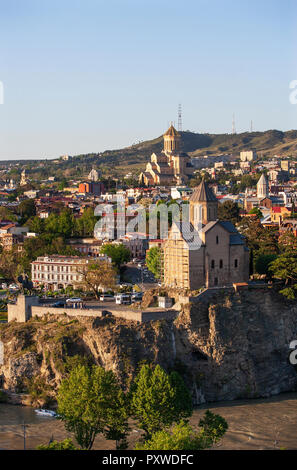 Georgia, Tbilisi, Kura river and Sameba Cathedral in old town - Stock Photo
