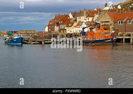 Trent class all-weather lifeboat 'George and Mary Webb' No. 14-14 moored outside the Whitby Lifeboat Station, Whitby Harbour North Yorkshire, England. - Stock Photo