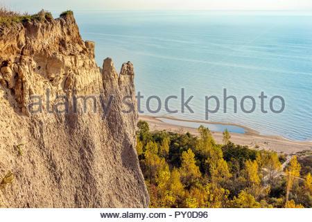 Sandstone cliff of the Scarborough Bluffs an escarpment beside Lake Ontario in Toronto Ontario Canada - Stock Photo