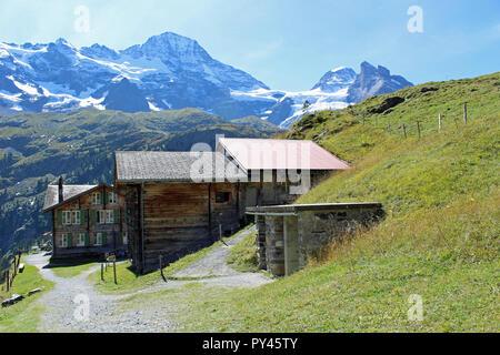 Hotel Obersteinberg. Mountain hotel two hours hike from nearest road in Stechelberg, Lauterbrunnen, Jungfrau region Switzerland. Backed by Wetterlucke - Stock Photo